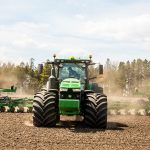 Tractor in a field planting safety